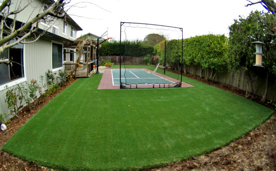 Sport court surrounded by artificial grass