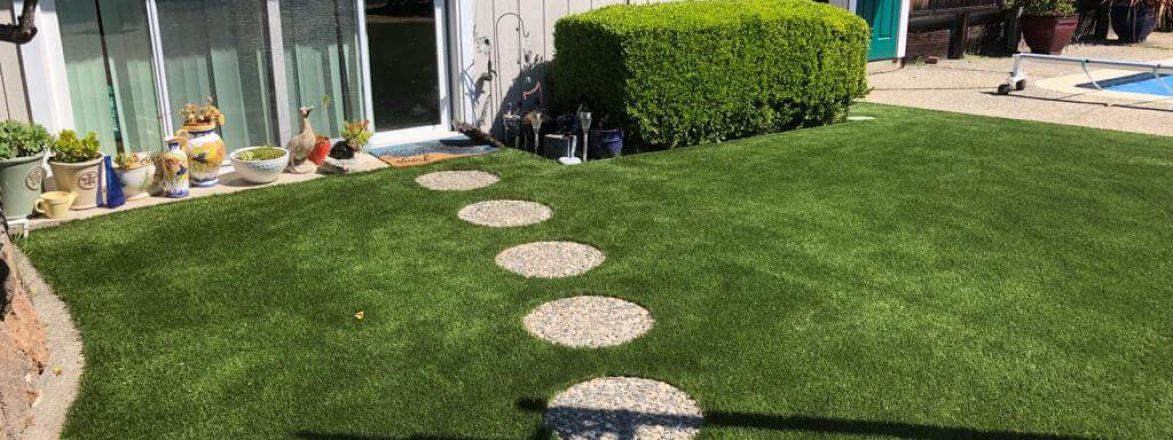 Artificial grass backyard around the pool in San Rafael, California