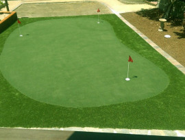 Three hole putting green in backyard