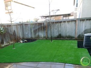 Backyard with a concrete patio (after)