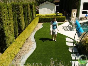 Synthetic grass around a swimming pool