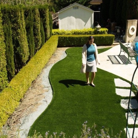 Synthetic grass around a swimming pool in Novato, California