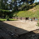 Synthetic turf & sod in a backyard (before)