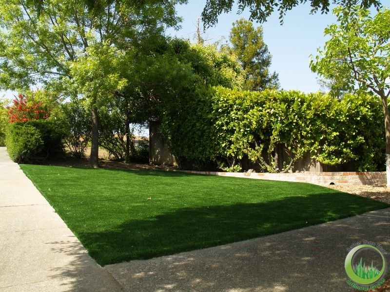 Installation of artificial synthetic grass in a front lawn in San Rafael, California