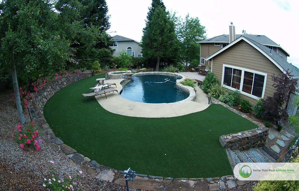 Installation Of Synthetic Grass Around Swimming Pools In