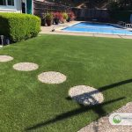 Artificial grass backyard around the pool in San Rafael, California