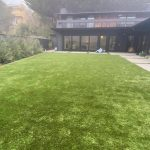Fake grass installation in residential back yard, Mill Valley, Marin County, California