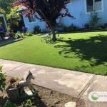 Artificial grass playground in backyard