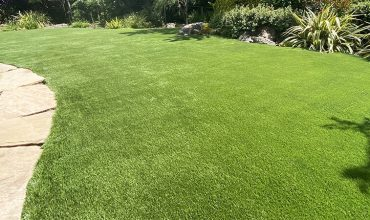 Artificial grass playground in backyard