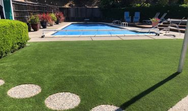 Is it a good idea to install Artificial Grass around a pool?